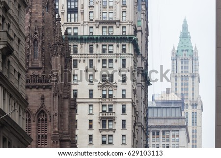 New York City, Lower Manhattan, arhitectural detail of Broadway street wiev: Trinity Church, New York City Charter School Center and Woolworth building far away.