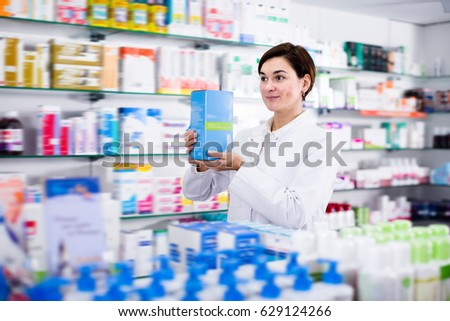 Adult female offering reliable medicine in pharmacy #629124266