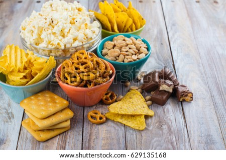 Assortment of unhealthy snacks. Diet or weight control concept. Space for text Royalty-Free Stock Photo #629135168