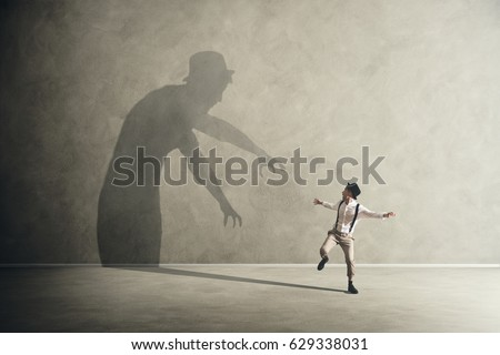 Man scared by his demon shadow
