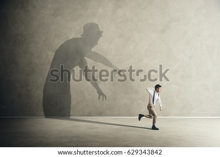Terrified man escapes from his scary fears shadows