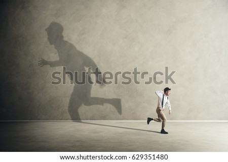 man and his shadows running in different direction