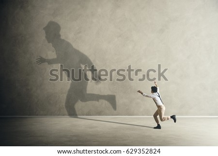 man trying to catch his shadow