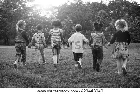 Group of Diverse Kids Playing at the Field Together #629443040