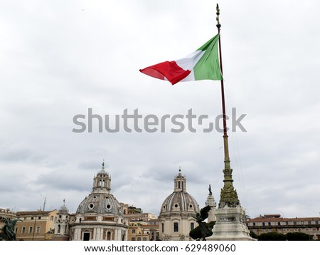 View of Rome, Italy. Flag and domes.  #629489060