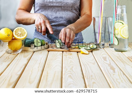 Healthy lifestyle, healthy food. A young woman prepares a detox drink from fresh vegetables and fruits. #629578715
