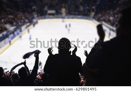 Fans support team in ice hockey stadium - happy people applause after winning goal.. #629801495