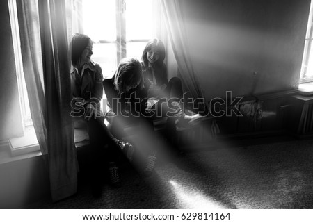 Elegant young girls in white shirts and leather jackets posing on window vintage interior. Fashion shot. #629814164