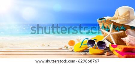 Beach Accessories On Table On Beach - Summer Holidays