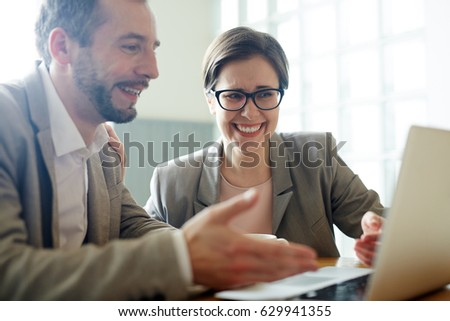 Confident man explaining his colleague online data #629941355