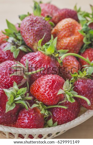 Ripe and tasty strawberries in a plate #629991149
