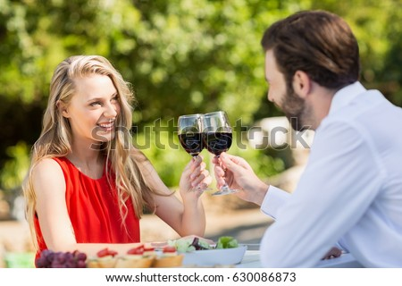 Happy couple toasting wine glasses in the restaurant #630086873