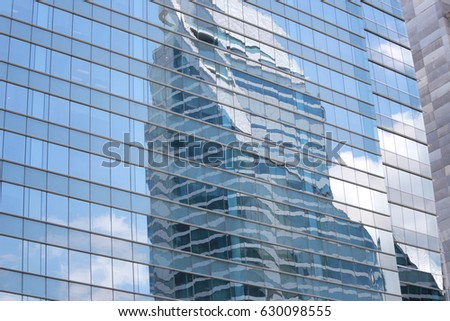 Blue Glass of Business tall buildings for design background. #630098555