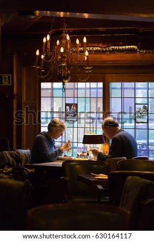 Amsterdam, The Netherlands - 11 April 2017 - Elderly European couple enjoy their dining together at a romantic restaurant in Amsterdam, The Netherlands on April 11, 2017. #630164117