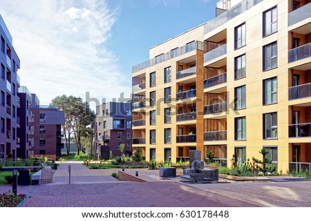 Benches at european complex of apartment residential buildings. And outdoor facilities. #630178448