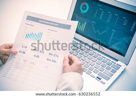 Business women reviewing data in financial charts and graphs #630236552