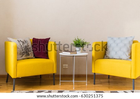 two yellow chairs by the coffee table in the living room #630251375