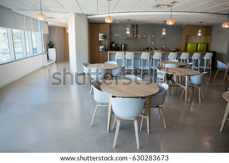Empty chair and table in cafeteria at office Royalty-Free Stock Photo #630283673