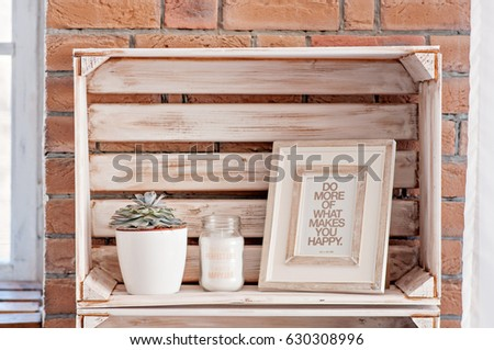 Bedroom decor elements in loft style: candles, coasters, succulents, pictures, photo frames