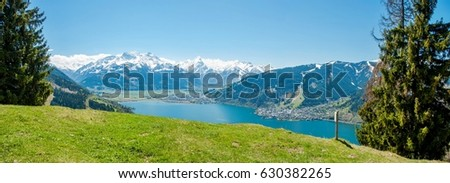 Beautiful panorama view over Zell am See lake in summer. Nature panorama of snowy Tirol Alps in Austria with lake Zeller. #630382265