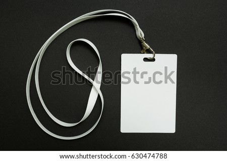 Blank badge mockup isolated on black. Plain empty name tag mock up hanging on neck with string, on white background.