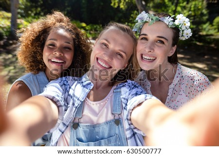 Female friends having fun in park on a sunny day #630500777