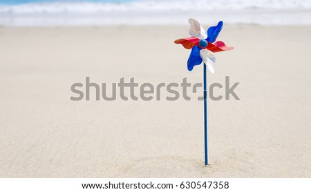 Independence Day USA background on the sandy beach near the ocean/ American Patriotic comcept  #630547358