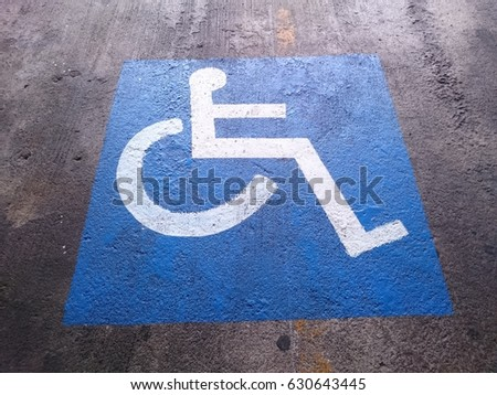 Disability sign in car parking area #630643445