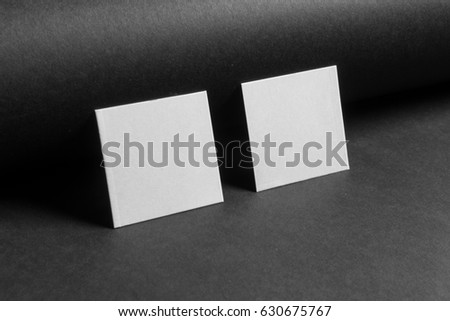 Mock-up of the two square business cards are on a black paper