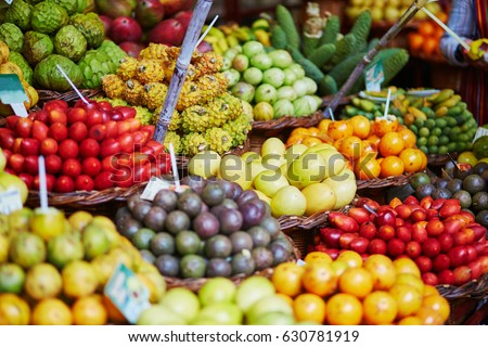 Fresh and ripe exotic fruits on traditional farmer market Mercado dos Lavradores, Funchal, Madeira island, Portugal #630781919