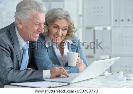 Pair of senior businesspeople working  #630783770
