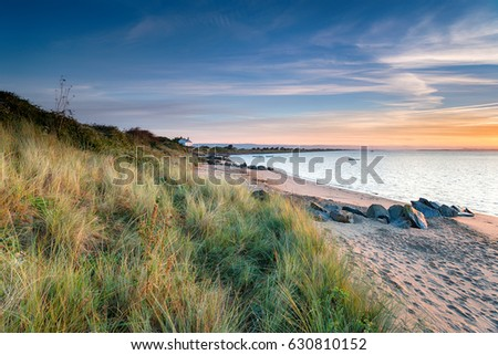 A white cottage on the shore at Crow Point on the north coast of Devon Royalty-Free Stock Photo #630810152