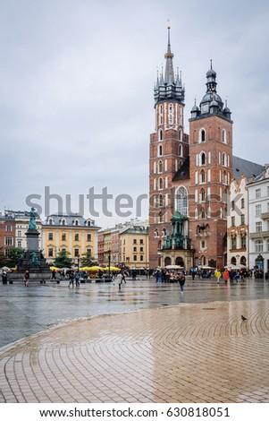 Krakow, Poland - 19th October 2016. Krakow's main market square on a rainy day in autumn. #630818051
