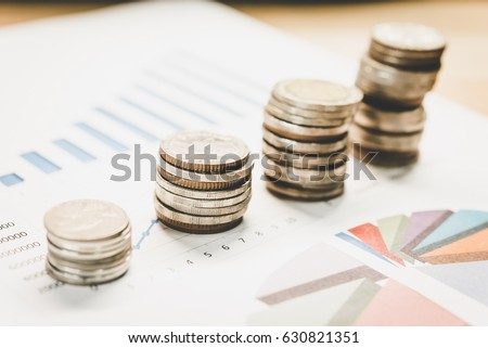 Personal financial planning concept. Businessman workplace with papers for financial planning. Business people discussing the charts and graphs showing the results of successful financial planning. #630821351
