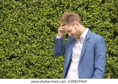 businessman  worried  at workplace. in park Stress concept #630829469
