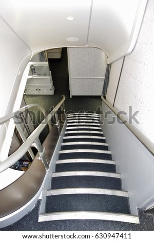 SEOUL, SOUTH KOREA -25 MAR 2017- View of the internal staircase inside a Boeing 747-8 airplane from Korean Airlines (KE). #630947411