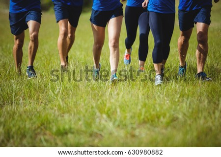 Low section of fit people running in boot camp #630980882