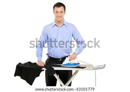Happy young man ironing his clothes isolated against white background