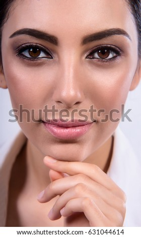 Beauty model with  makeup and fresh skin is posing front of the window. Youth and skincare concept.  Make-up and hair style. #631044614