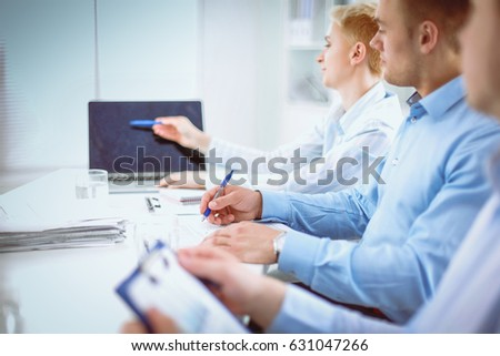 Business people sitting and discussing at meeting, in office #631047266