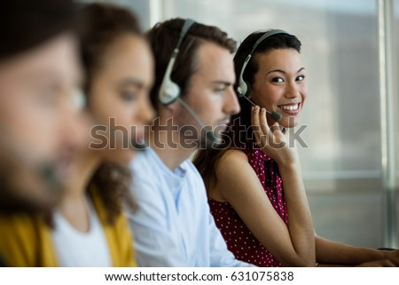 Portrait of customer service executive working at office #631075838