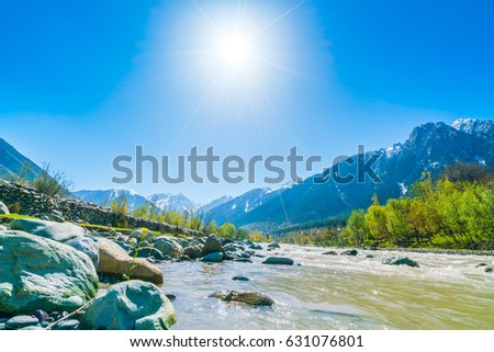 Beautiful  River and snow covered mountains landscape Kashmir state, India #631076801
