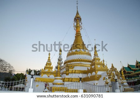 The pagoda in the temple at  capital District of Mae hong son city (province name) in northern Thailand.In the Near sunset. #631090781