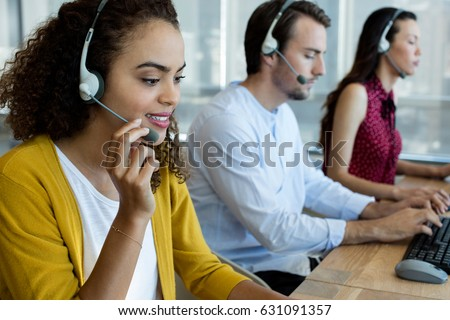 Customer service executives working at office #631091357