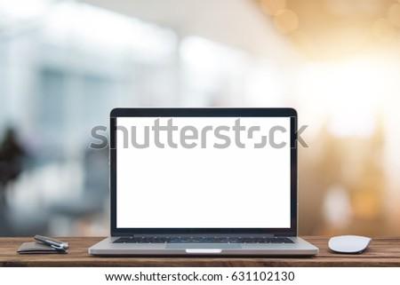 Laptop with blank screen and mouse with backlit sun