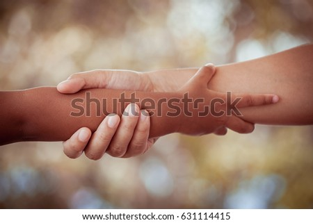 Mother and child daughter holding hand together with love in vintage color tone #631114415