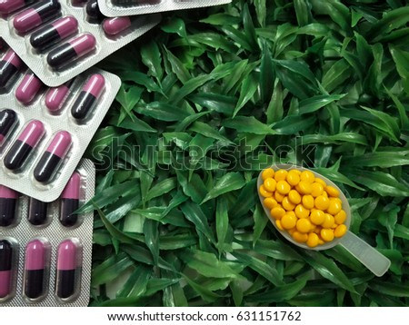 medicine pills in packs.packings of medicine pills and capsules and medicine in spoon #631151762