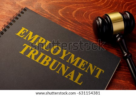 Book with title employment tribunal on a table. Royalty-Free Stock Photo #631154381