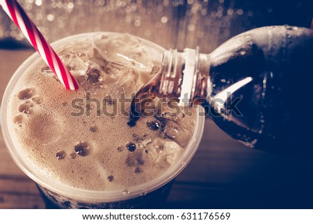 Refreshing Bubbly Soda Pop with Ice Cubes. Cold soda iced drink in a glasses - Selective focus, shallow DOF. #631176569