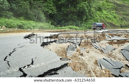 Asphalt Cracked Road Collapsed  Royalty-Free Stock Photo #631254650